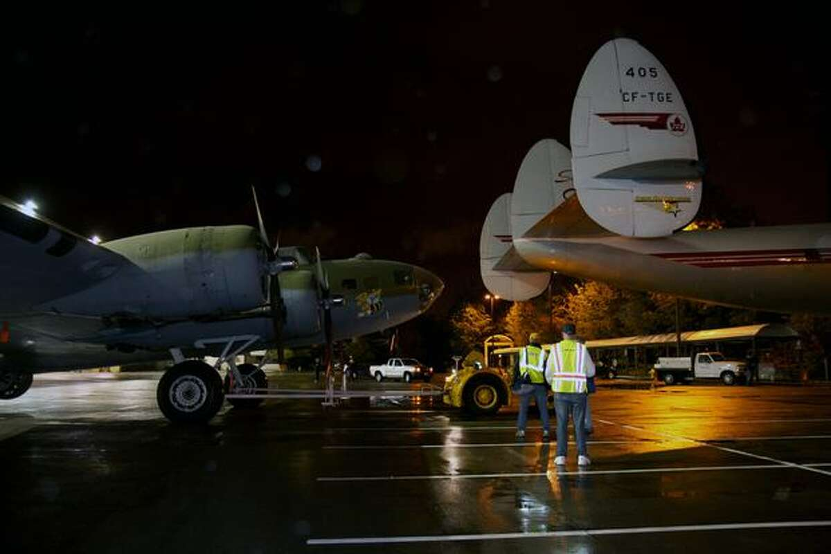 The Seattle Museum of Flight's Lockheed 1049G Super Constellation (right) and Boeing B-17 Flying Fortress are towed out of Boeing's Plant 2, in Seattle. (Ted Huetter/Museum of Flight)