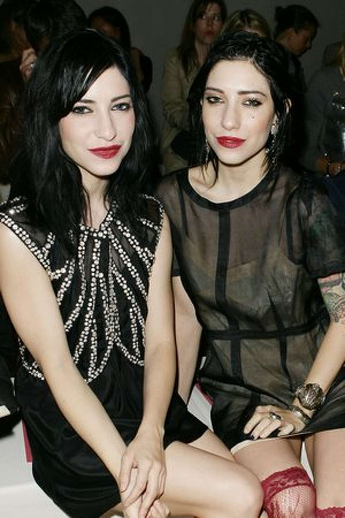 (L-R) Lisa Origliasso and Jessica Origliasso from the The Veronicas attends the DKNY Spring 2011 fashion show during Mercedes-Benz Fashion Week in New York City.