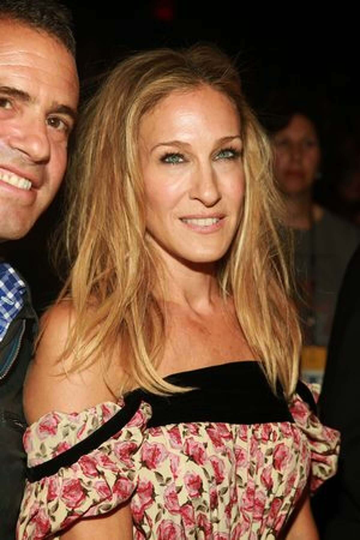Andy Cohen and Sarah Jessica Parker attend the Diane von Furstenberg Spring 2011 fashion show during Mercedes-Benz Fashion Week at The Theater in New York City.