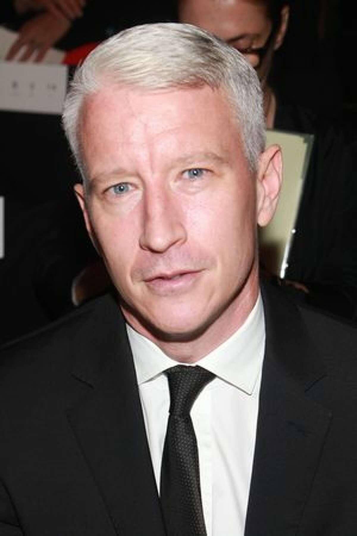 Anderson Cooper attends the Diane von Furstenberg Spring 2011 fashion show during Mercedes-Benz Fashion Week in New York City.