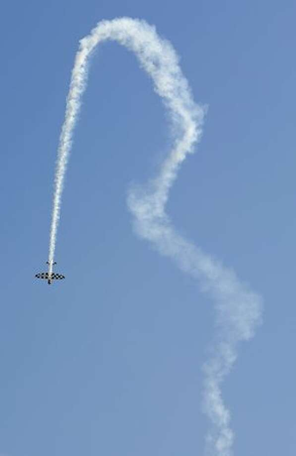 "A plane performs aerobatics during the ""The Party of Heaven"" air show 2010"" in Barcelona. Photo: Getty Images"