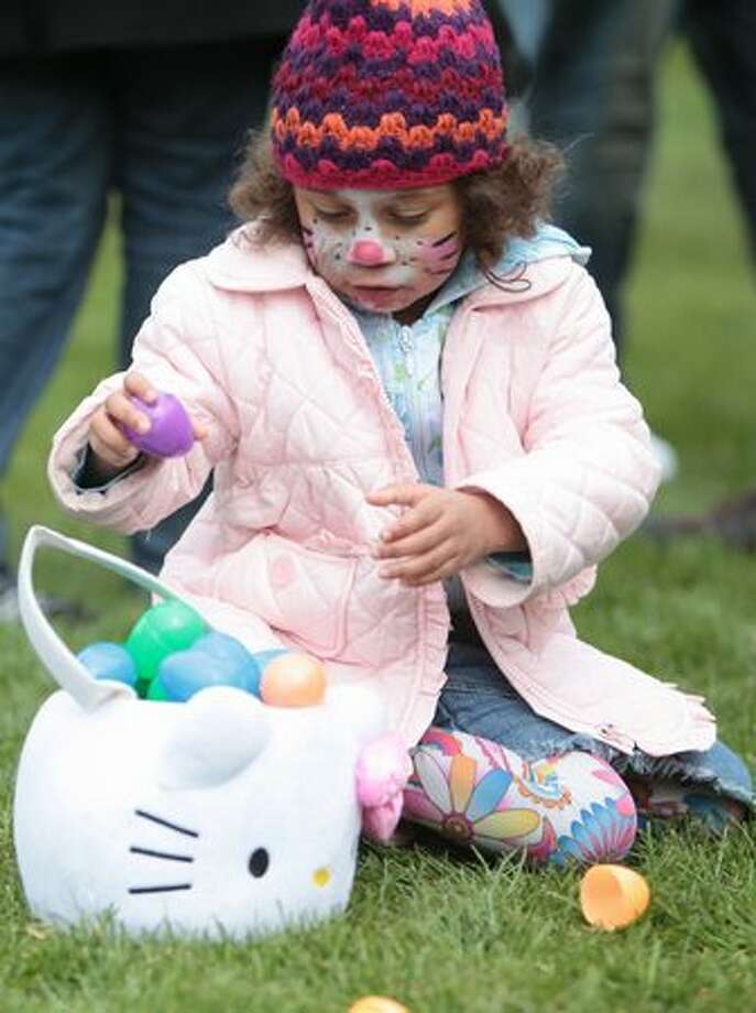 Marley Parks, 4, gathers plastic eggs during the annual Bunny Bounce Easter egg hunt at Woodland Park Zoo. Photo: Joshua Trujillo, Seattlepi.com