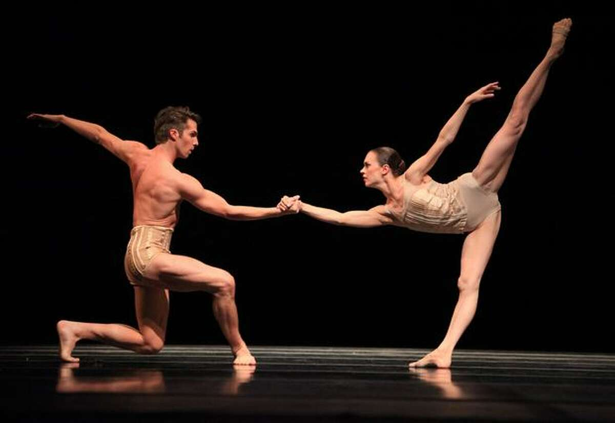 Pacific Northwest Ballet dancers Lucien Postlewaite and Rachel Foster perform