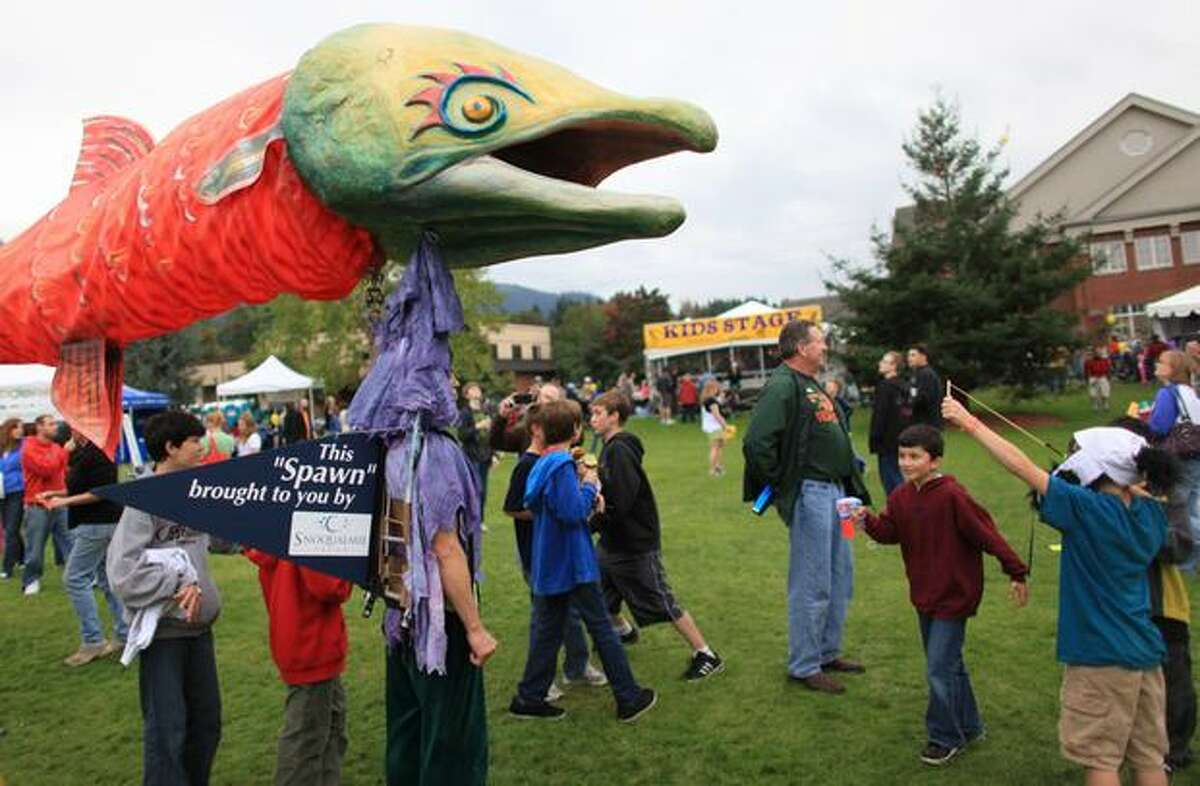 """A """"salmon"""" meanders through the crowd during the Issaquah Salmon Days festival on Sunday, October 3, 2010."""