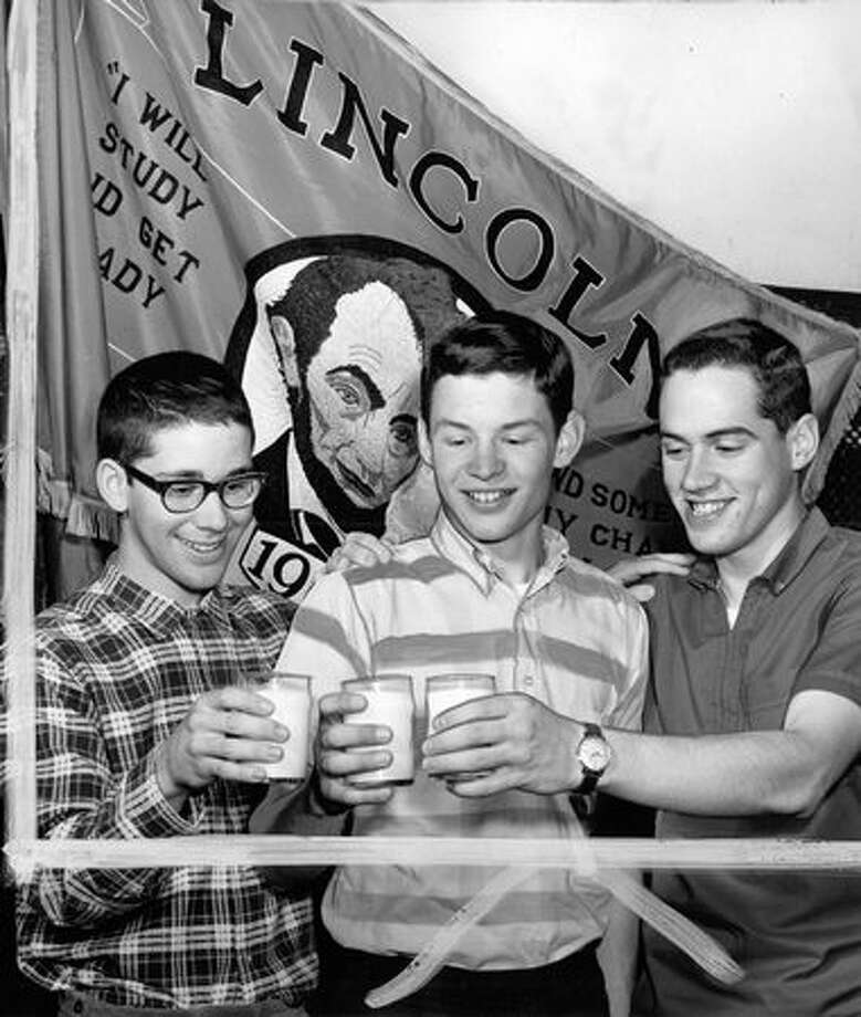 The April 1964 photo caption read: Mark Schiller, Jon Rynak and Ed Davenport, top Lincoln scholars, made 'Grade-A' toast with milk. [Marks were made by a former P-I photo editor.] Photo: P-I File