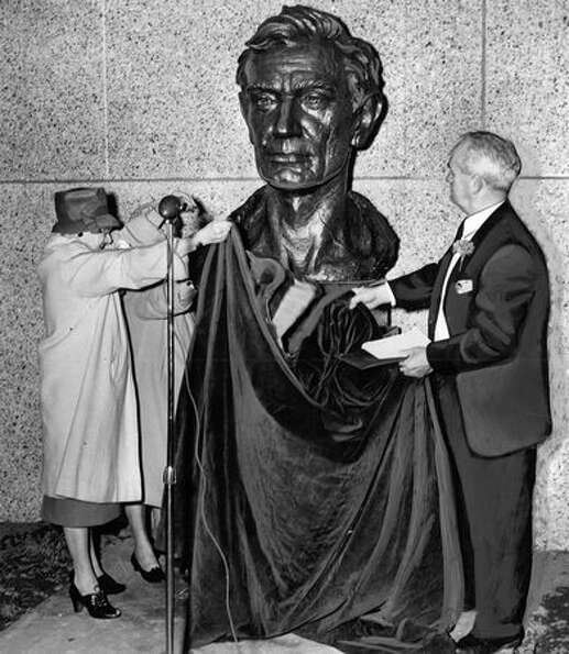 The February 1964 photo caption read: A bronze casting of Lincoln is uncovered at Lincoln High Schoo