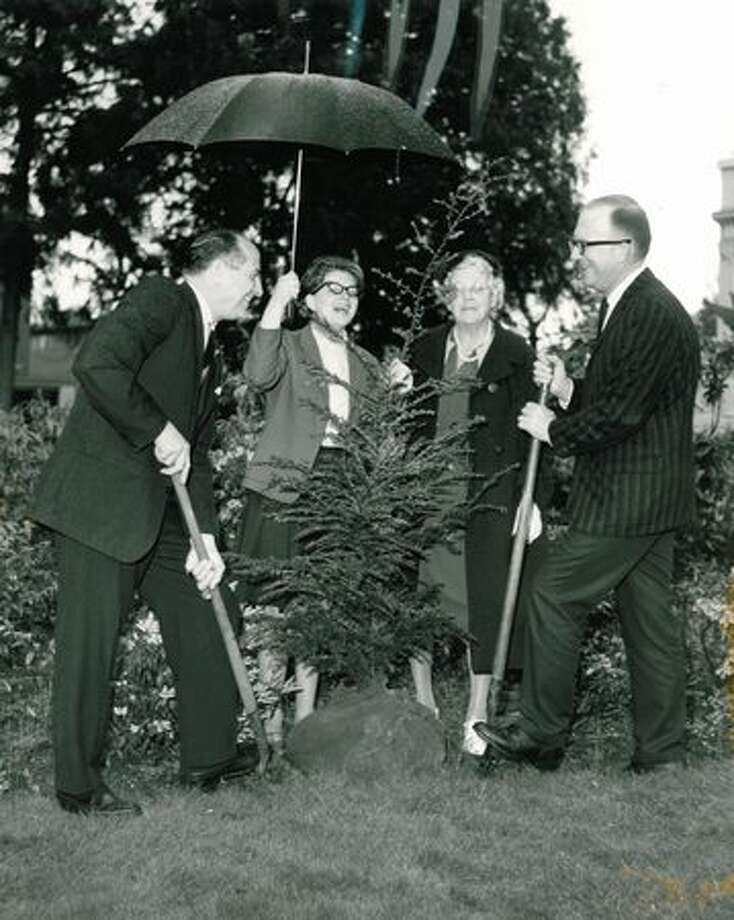 The April 1963 photo caption read: Left to right: Governor Albert D. Rosellini, Miss Shery Ehmer of Olympia, Junior Audubon Society; Miss Margaret McKenney, President, Olympia Audubon Society; and Robert Carpenter, Driector of State Capitol Museum. Photo: P-I File