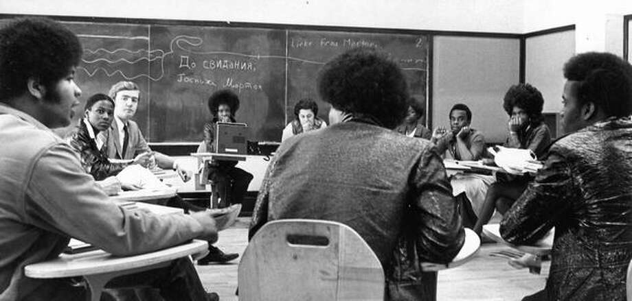Taking part in a conflict-resolution session of Queen Anne High School were, from left, Robert Hubbard, Pansy Smith, school psychologist Tom Wall, Carolyn Wiggins, counselor Nancy Lilly, Roxanne Browne, Darryl Holiday, Helen Brown, Walter Warren and Lardell Barton. June 9, 1971. Photo: P-I File