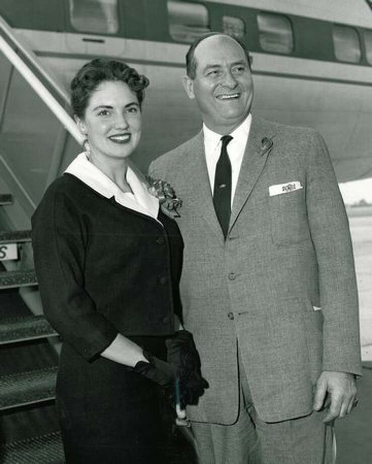The January 1960 photo caption read: Governor Albert D. Rossellini and Sharon Vaugn, Miss Washington of 1959, are shown as they arrived in Southern California to root for the University of Washington in the Rose Bowl game on New Year's Day. Photo: P-I File