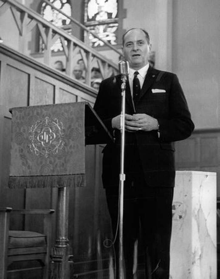 Gov. Albert D. Rosellini expressed concern during the March 1960 fishermen's festival at Ballard's First Lutheran Church about the Geneva meeting on law of the sea. Photo: P-I File