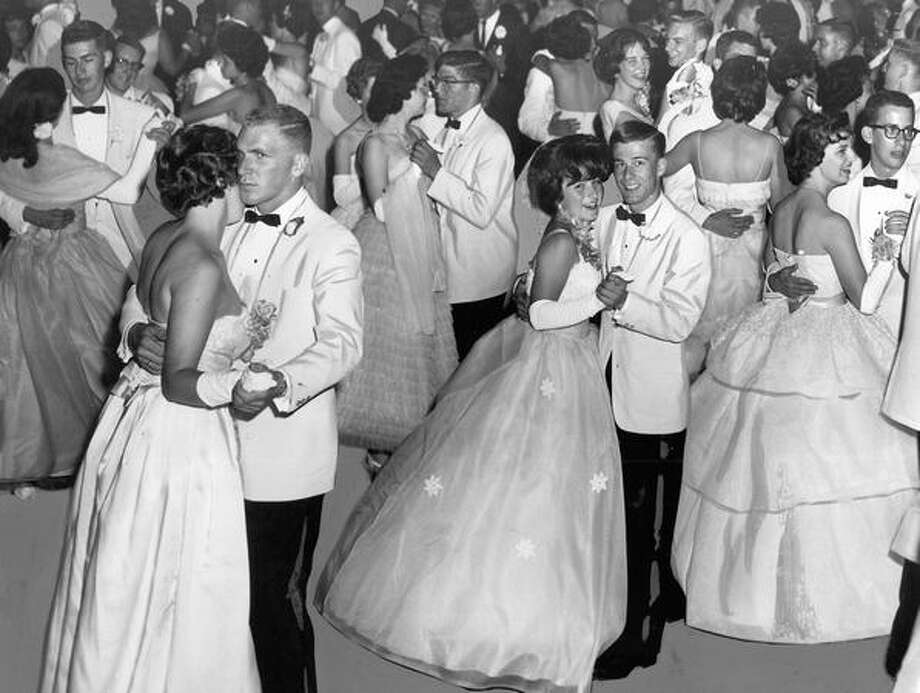 The original photo caption read: All dressed up in party-going finery, Queen Anne High School's graduating class starts its all-night celebration ending Senior Week with a prom in the Grand Ballroom of the Olympic Hotel. June 11, 1961. Photo: P-I File