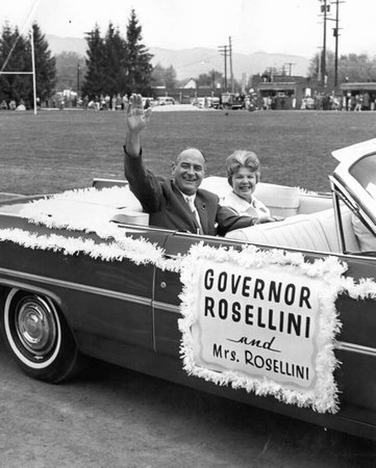 The May 1963 photo caption read: Gov. and Mrs. Albert D. Rosellini ride in the Apple Blossom Festival parade in Wenatchee. Photo: P-I File