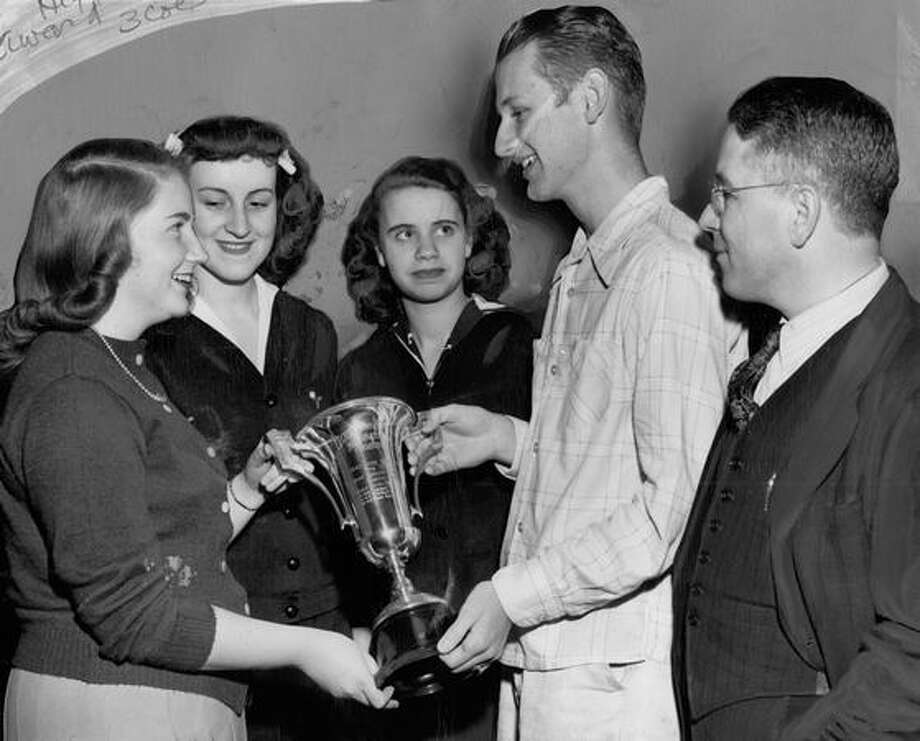 "The original photo caption read: Joanne Campion, left, voted most inspirational member of Queen Anne High School chapter of Quill and Scroll, here admires school's ""inspiration"" cup, on which her name will be inscribed. May 1, 1947. Photo: P-I File"