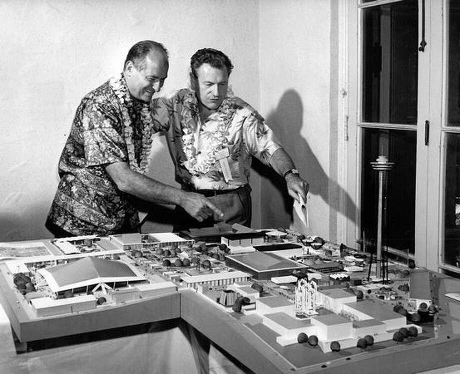 The July 1961 photo caption read: Gov. Albert D. Rosellini of Washington State gives New York Gov. Nelson Rockefeller, right, a briefing on the Seattle World's Fair at a site model of the fair during the just concluded National Governors Conference in Hawaii. Rockefeller gave his strong support to the Seattle fair. Photo: P-I File