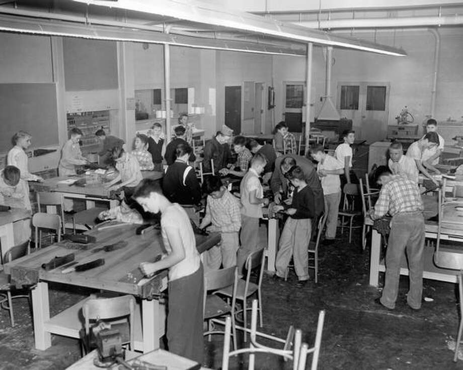 The November 1955 photo caption read: Carpentry crafts class in new addition to Queen Anne High School. Photo: P-I File