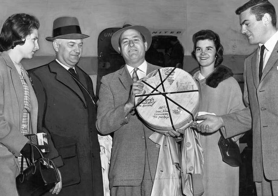 The Jan. 4, 1960 photo caption read: A wonderful wheel of Wisconsin's finest cheese is Gov. Albert D. Rosellini's prize for his patriotic pick of Washington to win in the Rose Bowl. Photo: P-I File
