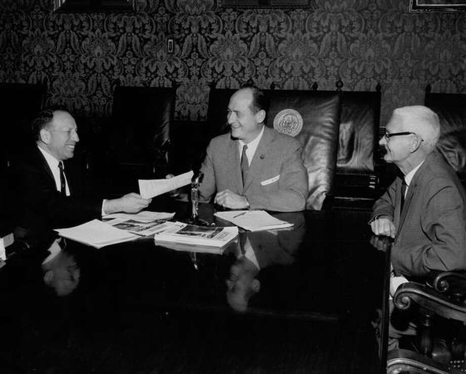 Dr. Bernard Bucove, Gov. Albert D. Rosellini and Orual C. Scott, Nov. 30, 1962. Photo: P-I File