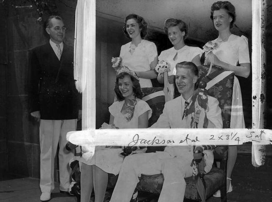 Broadway royalty in June 1945. According to the original photo info, Edwin L. Wick and Marilyn Jackson, king and queen, are seated. Earl A. Pfaff, school principal, is on the left. In the rear, from left, are: Princesses Roberta Moore, Jean Wells and Marilyn Johnson. Photo: P-I File