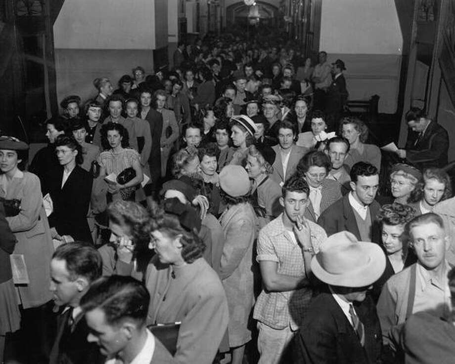 The September 1946 photo caption read: This is a small part of the crowd jamming corridors of Broadway-Edison Technical School last night when registration opened for night classes. Besides this and two other hallways, people packed several registration rooms and overflowed through front doors. Photo: P-I File