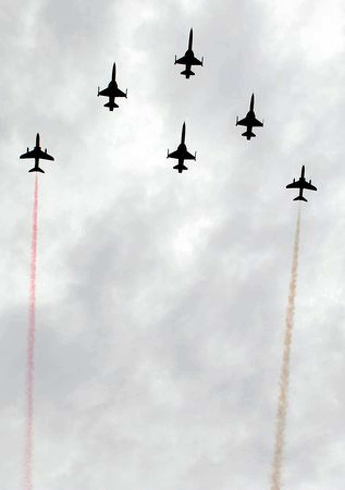 South Korean-made Indonesian fighter jets maneuver during the 65th Indonesian military anniversary in Jakarta.