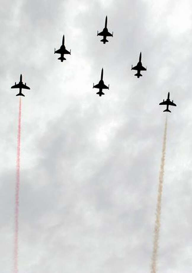 South Korean-made Indonesian fighter jets maneuver during the 65th Indonesian military anniversary in Jakarta. Photo: Getty Images