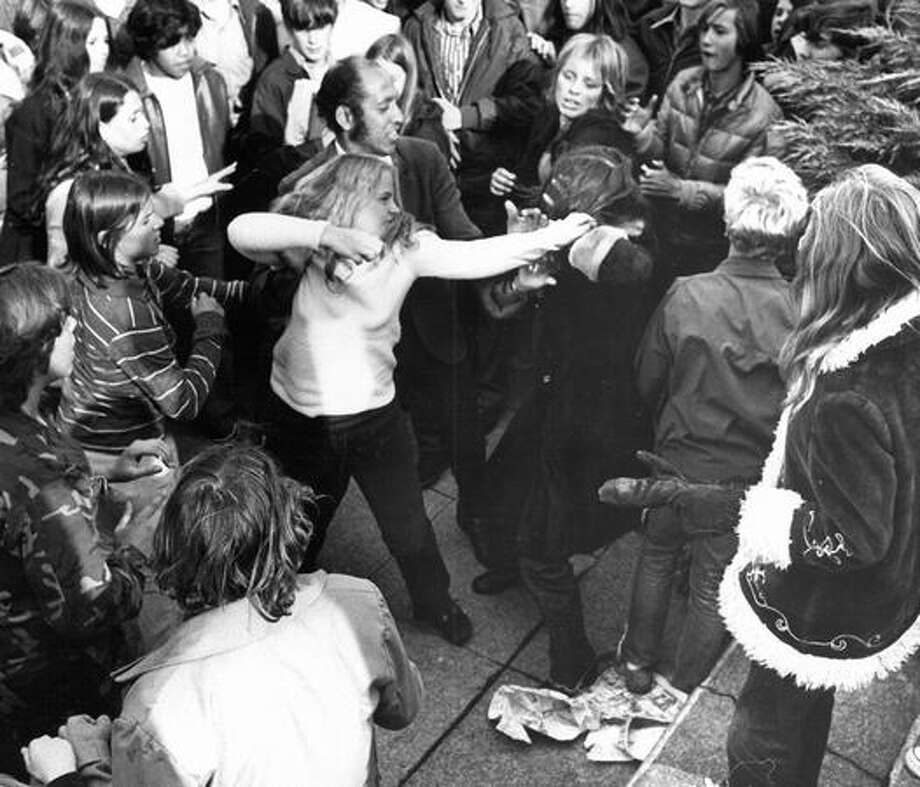 The October 1971 photo caption read: Girl students from Lincoln High School tangled over racial issue near campus. Warren Burton, center, state aide on racial matters, attempted to break up the scrap yesterday. Photo: P-I File