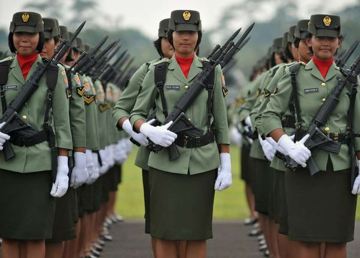 Indonesian army troops line up during a rehearsal of the 65th anniversary ceremony in Jakarta.