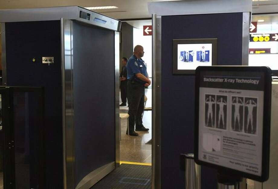 A backscatter X-ray body scanner recently installed at Sea-Tac Airport. Photo: Aubrey Cohen, Seattlepi.com
