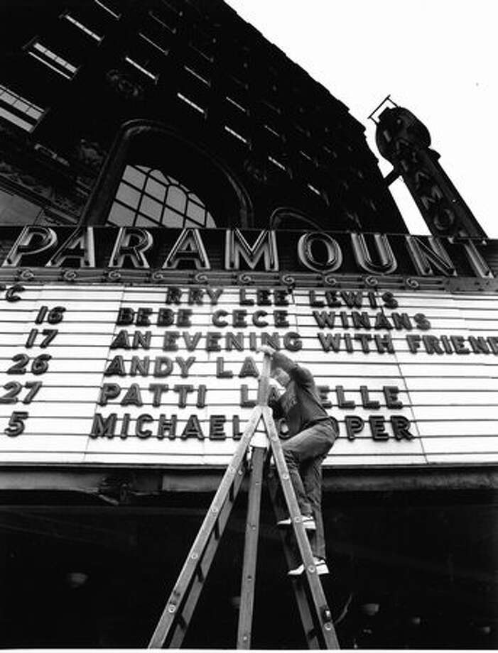 Michael McManus, the Paramount Theater's ticket manager, adjusting the marquee on Dec. 15, 1989. Photo: P-I File