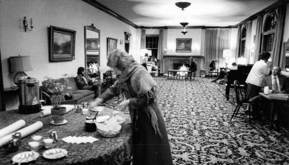 """The lobby of the Harvard Exit, shown here in September 1972, was described as """"a large, warm living room with a free coffee, tea, crackers and cheese table."""" Photo: P-I File"""