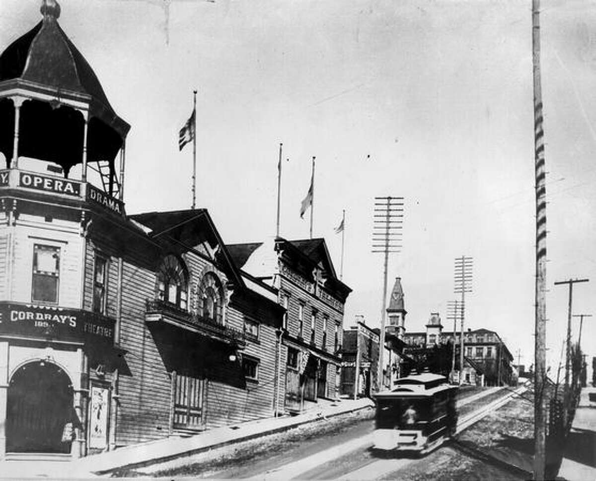 The original caption read: A streetcar speeds past Cordray's Theater at Third Avenue and Madison Street on its way to Madison Park, circa 1892. [NOTE: The building was demolished during the 1907 regrade of Third Avenue.]