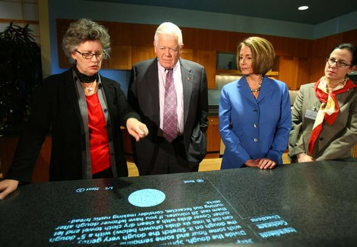 From left: Flora Goldthwaite, a Microsoft program manager, explains an interactive countertop to U.S. Rep. Jim McDermott, House Speaker Nancy Pelosi and her daughter Nancy Corrine Pelosi in Microsoft's Home of the Future on Thursday at the Microsoft campus in Redmond.