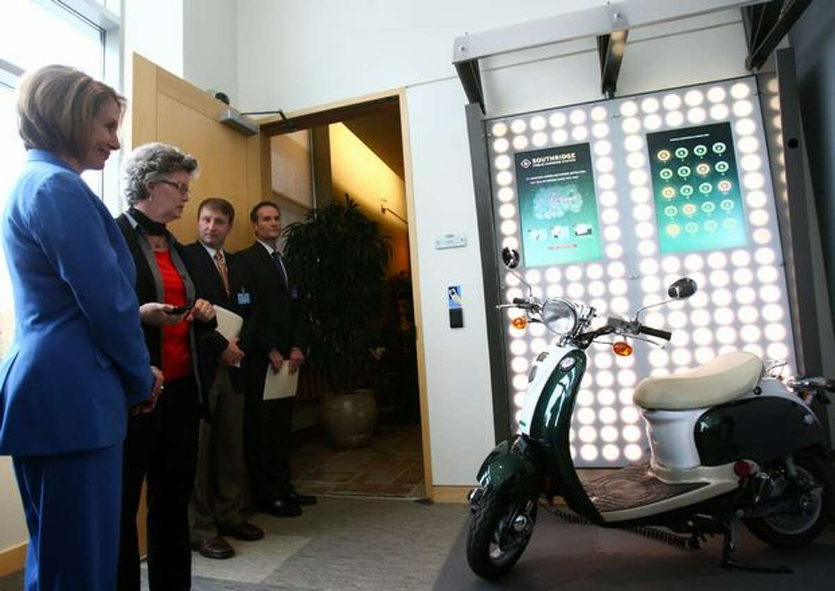 House Speaker Nancy Pelosi, left, prepares to enter Microsoft's Home of the Future on Thursday at the Microsoft campus in Redmond.