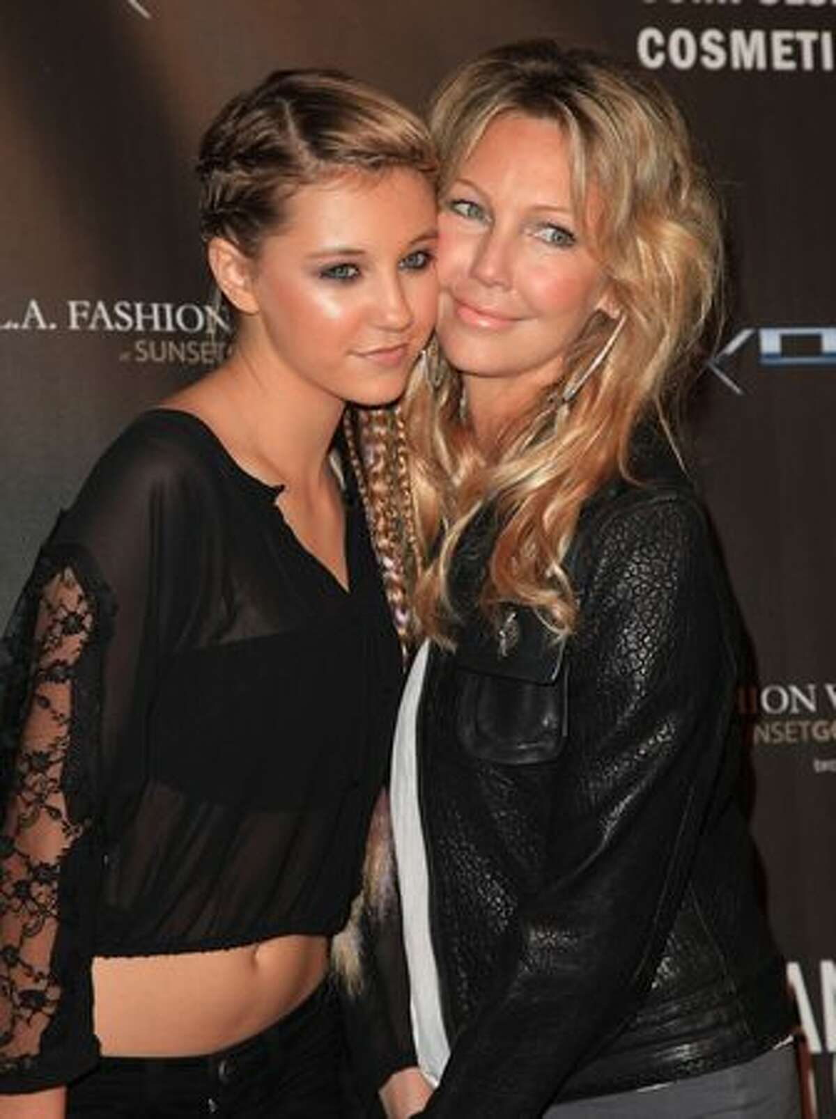 Ava Sambora and her mother Heather Locklear arrive at the WTB Spring 2011 Fashion Show at Sunset Gower Studios in Los Angeles, California.