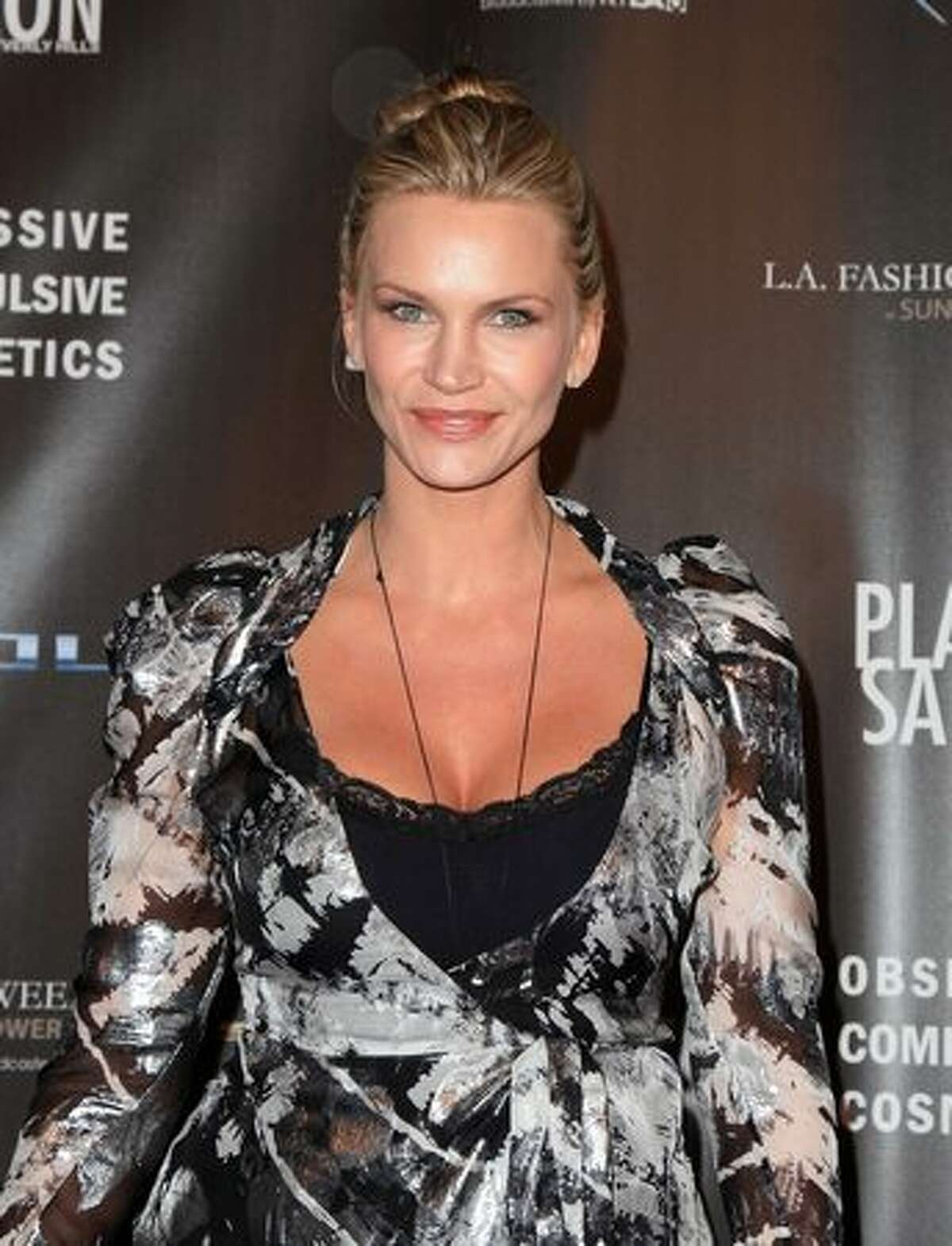 Actress Natasha Henstridge arrives at the WTB Spring 2011 Fashion Show at Sunset Gower Studios in Los Angeles, California.