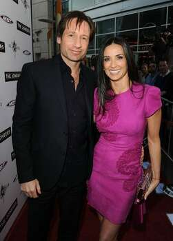 "Actor David Duchovny and Actress Demi Moore arrive at Roadside Attractions & Echo Lake Entertainment's premiere of ""The Joneses"" held at Arclight Hollywood Cinema on April 8, 2010 in Los Angeles, California. Photo: Getty Images"