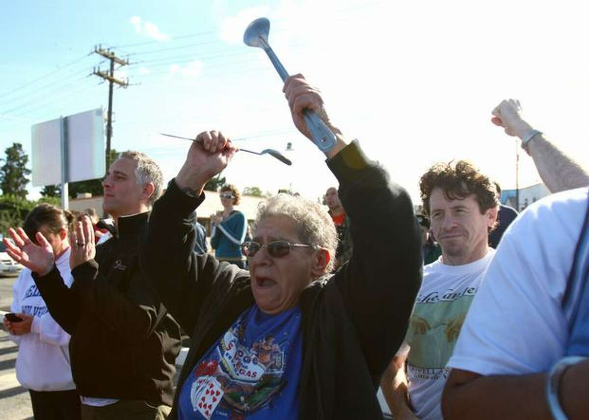Juanita Rivera cheers as funding for the South Park Bridge replacement is officially announced on Friday, October 15, 2010 in South Park. The bridge has been closed since June.