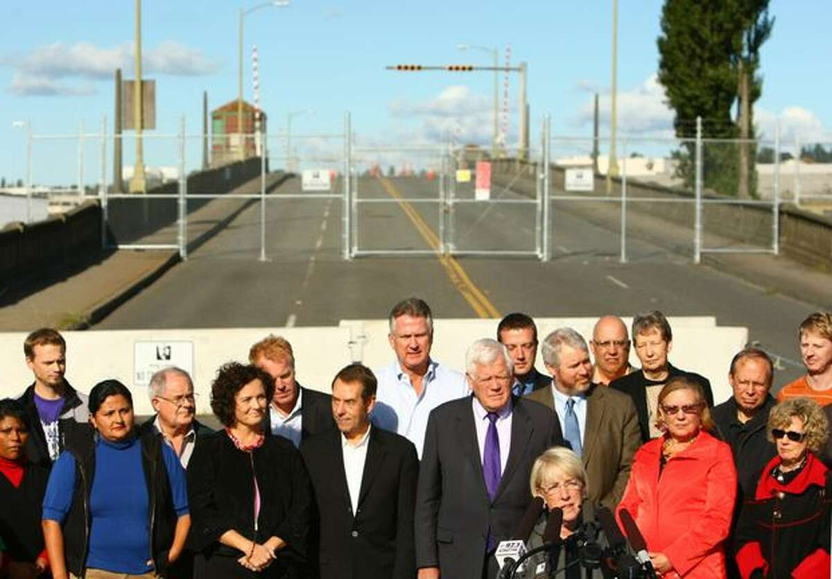 Local politicians and community leaders stand behind U.S. Senator Patty Murray as she officially announces funding for a replacement for the South Park Bridge on Friday, October 15, 2010 in South Park. The bridge has been closed since June.