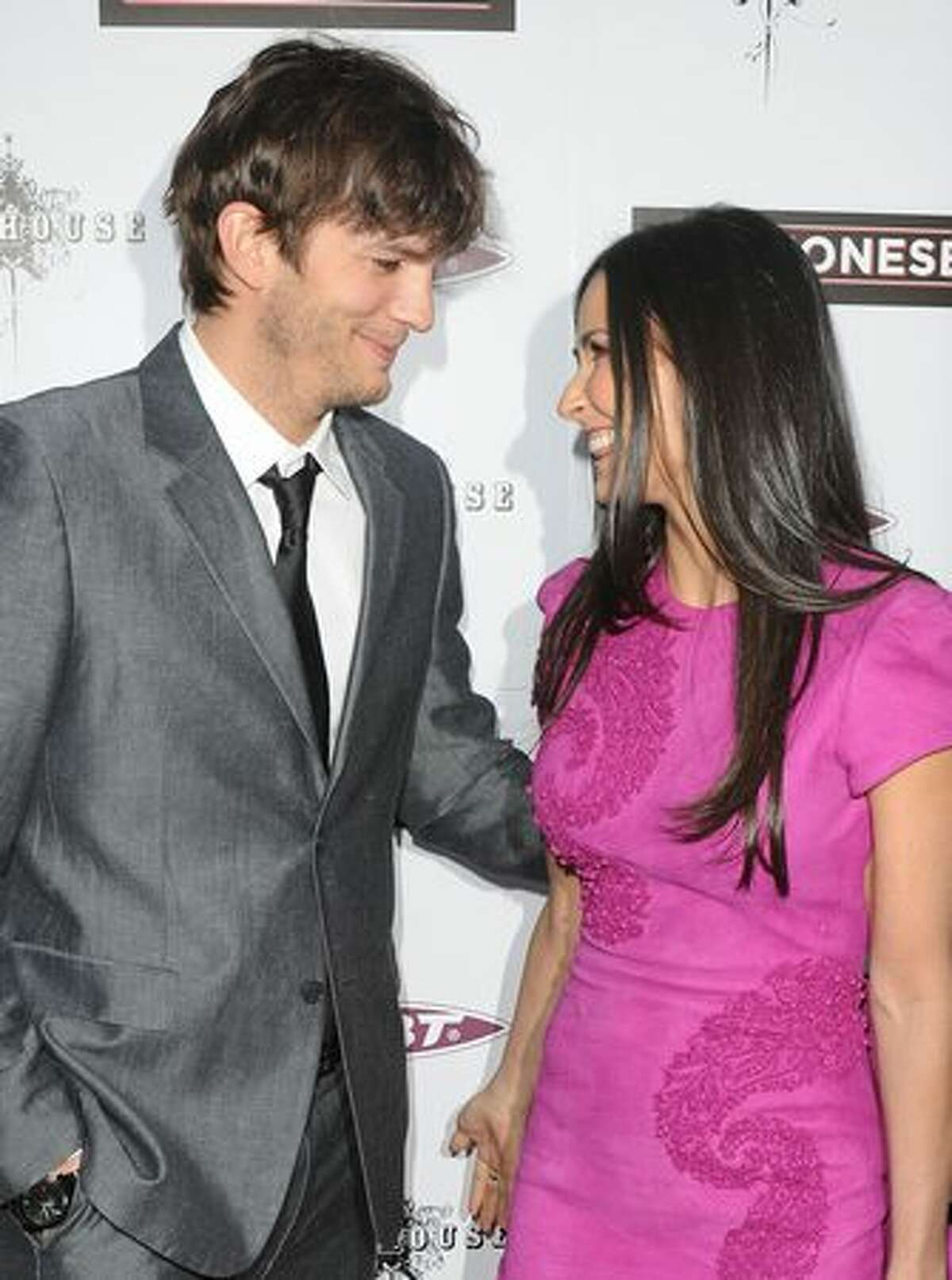 Actors Ashton Kutcher and Demi Moore arrive at Roadside Attractions & Echo Lake Entertainment's premiere of 'The Joneses' held at Arclight Hollywood Cinema on April 8, 2010 in Los Angeles, California.