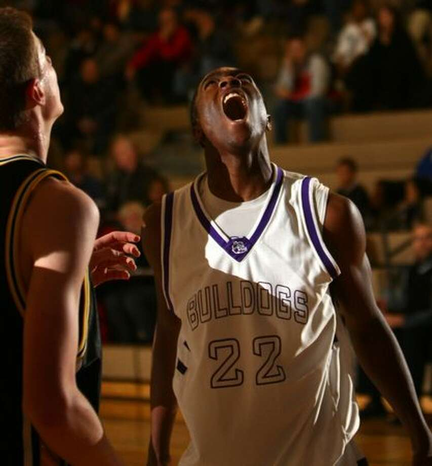 Garfield High School basketball player Tony Wroten Jr. lets out a roar as the ball rolls into the hoop in 2007.  Photo: P-I File