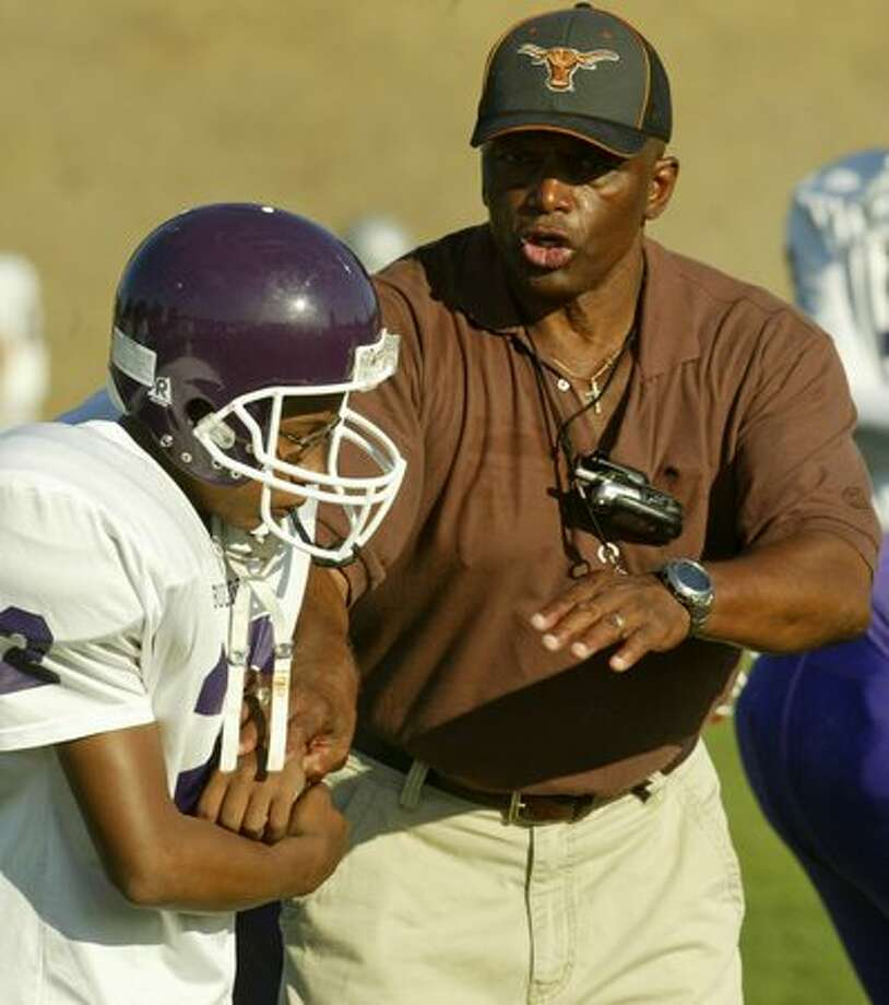 Al Roberts returned to be Garfield High's co-head coach with Anthony Allen in 2006. In this picture, he's giving running advice to Taji Thomas during practice. Photo: P-I File