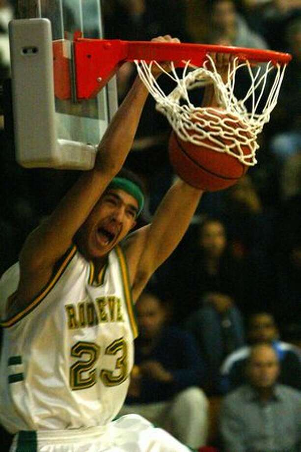 Roosevelt's Marcus Williams dunks the ball in Roosevelt's defeat of Franklin 81 to 61, February 2004. Williams was the 33rd overall pick in the 2007 NBA draft. Photo: P-I File