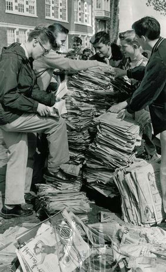The April 1951 photo caption read: With scrap paper bringing $13 a ton, these Garfield High School students are piling up a good stack of profits for their school yearbook and athletic fund during big paper drive this week. Photo: P-I File