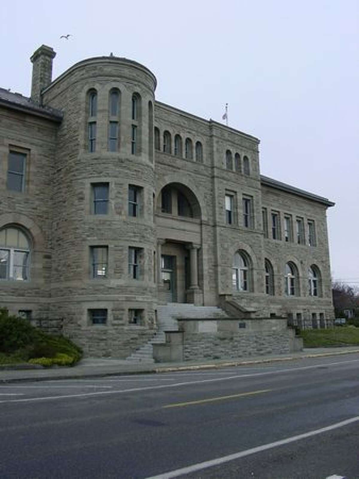 Port Townsend Customs House/Post Office, Port Townsend, WA : The Port Townsend Customs House and Post office is a fine example of Richardsonian Romanesque style, and today the stone building stands unaltered. Built at a time when it was expected that Port Townsend would develop into a major port city, the Customs House has retained its historic form while continuing to provide for the community for over a century. The front entrance facade was used as the