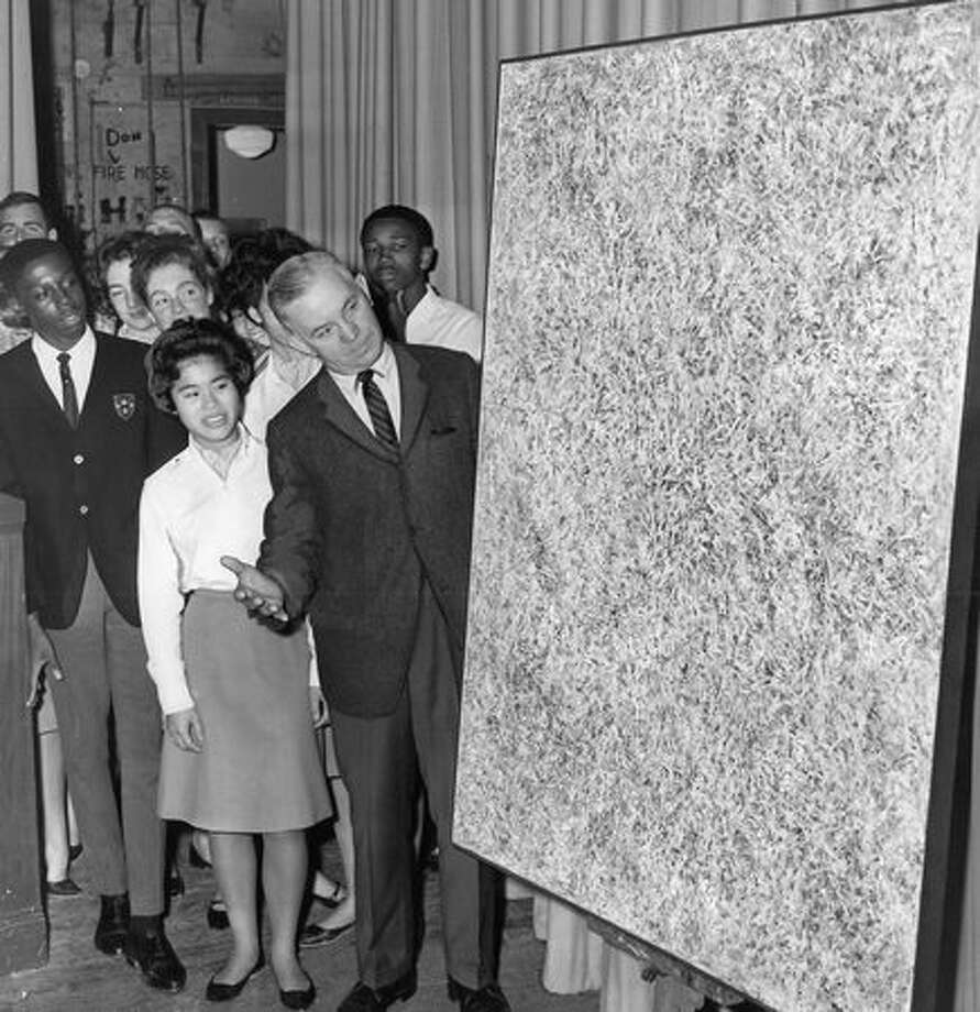 The October 1963 photo caption read: Garfield High School students watch intently as Paul Skoog explains the Paul Horiuchi abstract painting he and Mrs. Skoog presented to the shool yesterday in appreciation for the education received by the Skoogs' three children at Garfield. Photo: P-I File