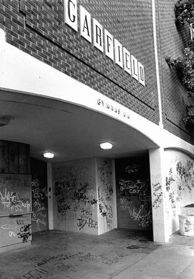 The July 1987 photo caption read: Graffitti disfigures the walls of Garfield High School. The School Board wants principals to notify police about students drawing on buildings. Photo: P-I File
