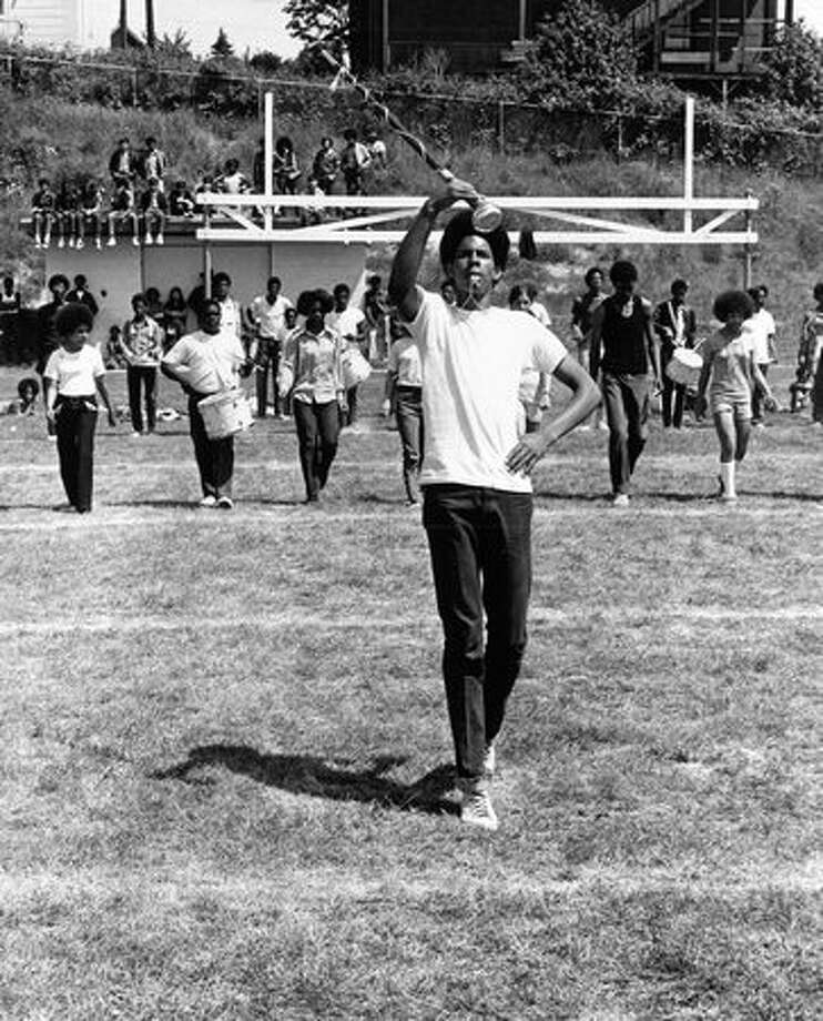 The May 1971 photo caption read: Keith Harrell, one of drum majors for Garfield 100, put a drill team through one of the maneuvers learned in a week. Photo: P-I File