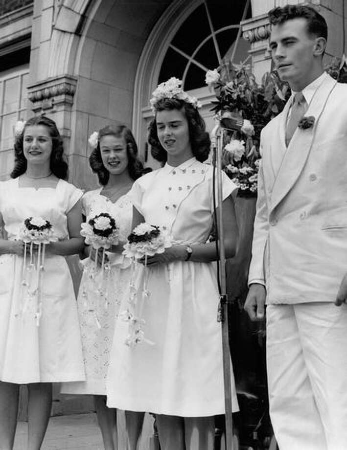 The May 1947 photo caption read: Royalty for a day were these four Garfield High School students elected by popular vote to head the school's annual Purple and White Day yesterday. Photo: P-I File