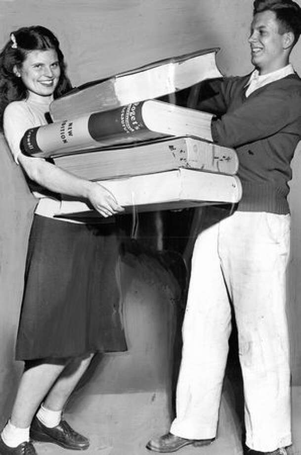 "The February 1947 photo caption read: Sheila McFadden carries oversize books for Dick Brown as Garfield High School girls devoted day to showing boys ""the common courtesies you show us the other 364 days of the year."" Photo: P-I File"