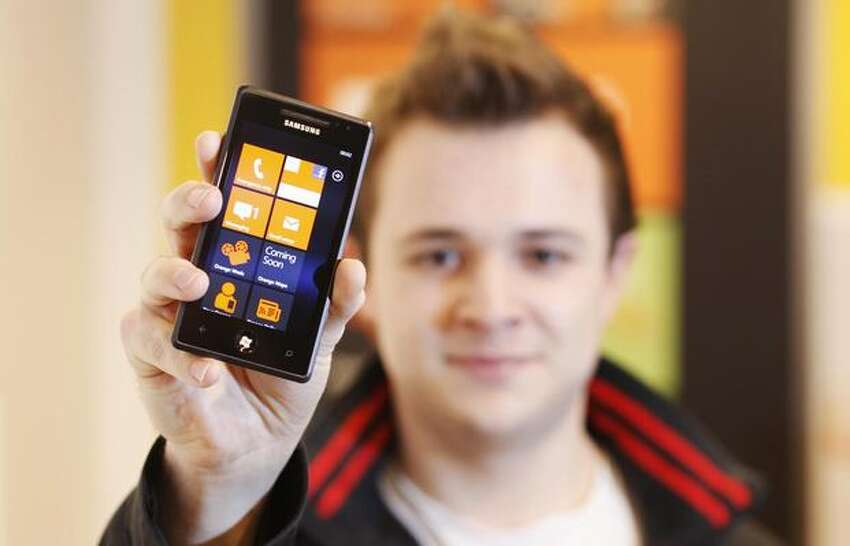 Andrew Willett, 22, of London gets his hands on the first Windows Phone 7 at the Orange Shop Oxford Street on Thursday in the English capital. (David Parry/PA Wire)